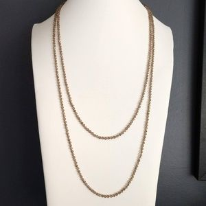 Delicate long single strand crystal necklace